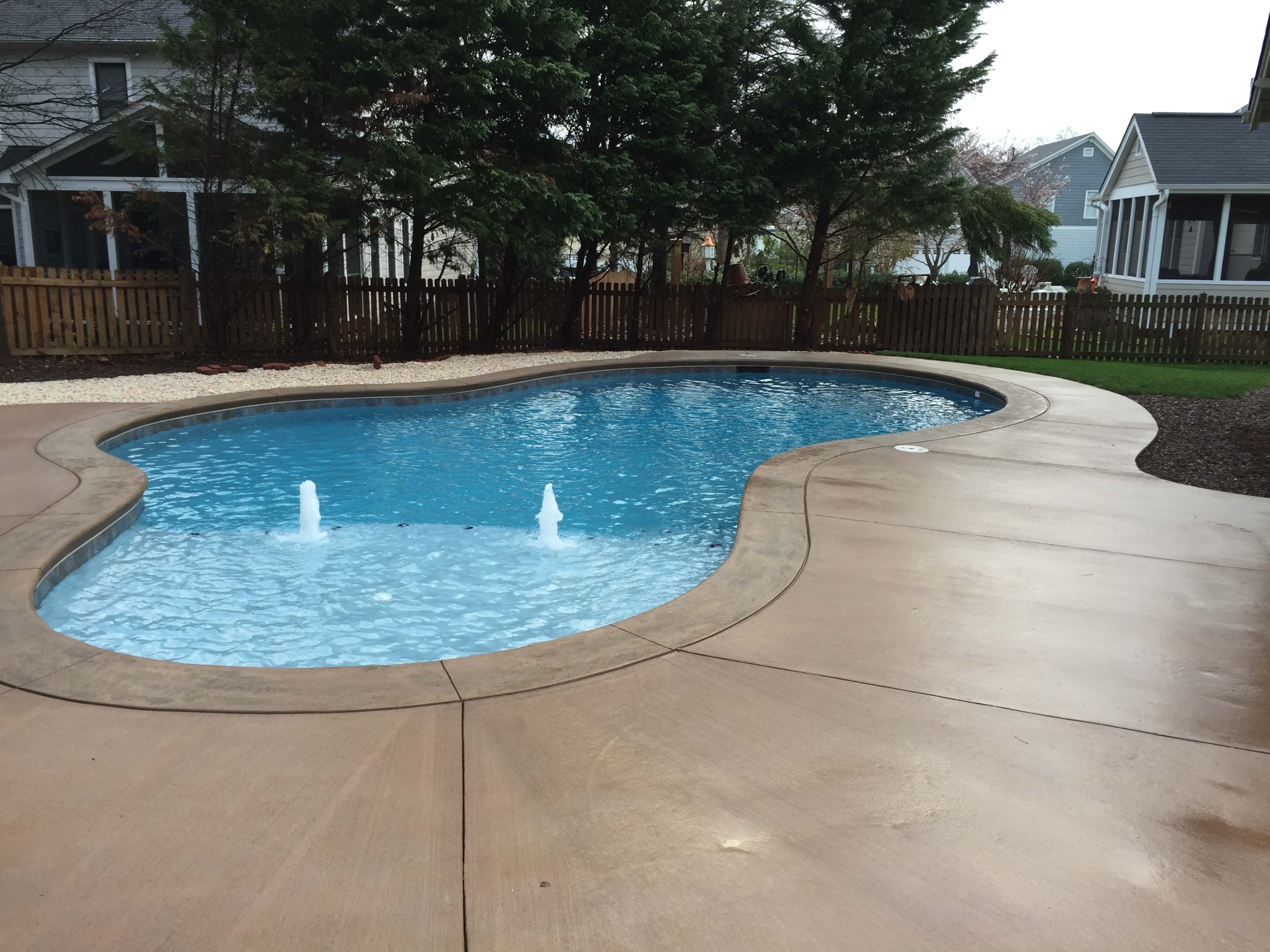 Free form pools backyard oasis pools high quality pool for Quality pool design